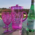 Pink acrylic jug and glasses for outdoor dining