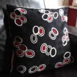 Fairwind contemporary black and red pebble cushion
