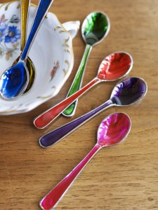 Six jewel colour spoons
