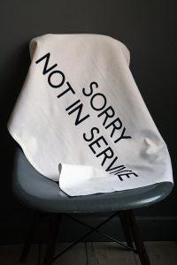Sorry Not in Service designer tea towel