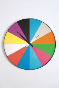Multi coloured wheel design wall clock by Thomas Bucheim