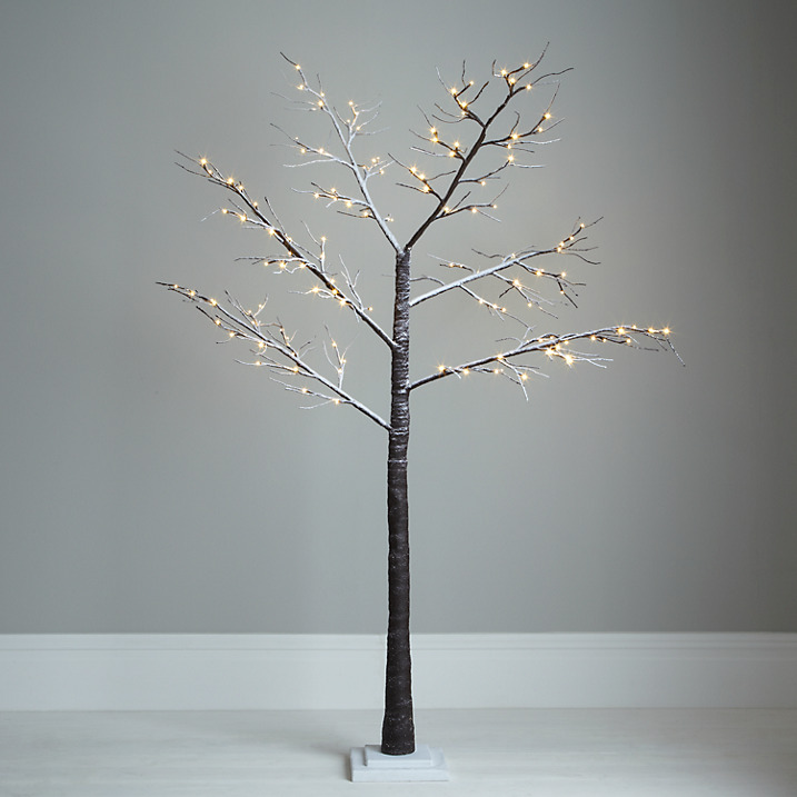 Outdoor lit snowy paper twig tree