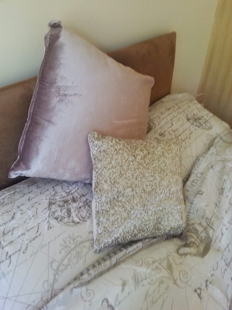 Pink and cream velvet and beaded cushions from Tesco