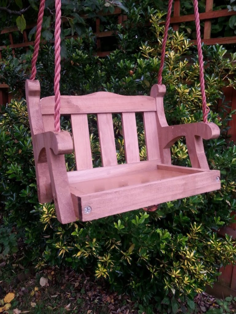 Quirky wooden swing seat design hanging bird feeder