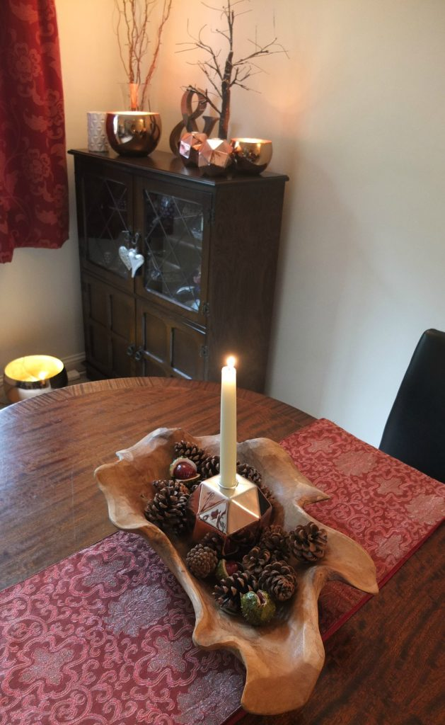 Using copper and wood trends to create a cosy winter dining room