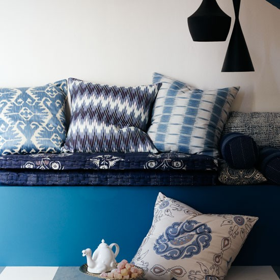 Relax on a day bed piled high with soft indigo blue design cushions