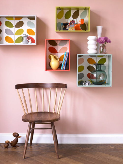 This is a great idea for transforming plain shelves or wall units into statement pieces.