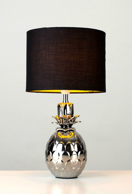 Love how this lamp creates a golden glow on the pineapple base when it's turned on.