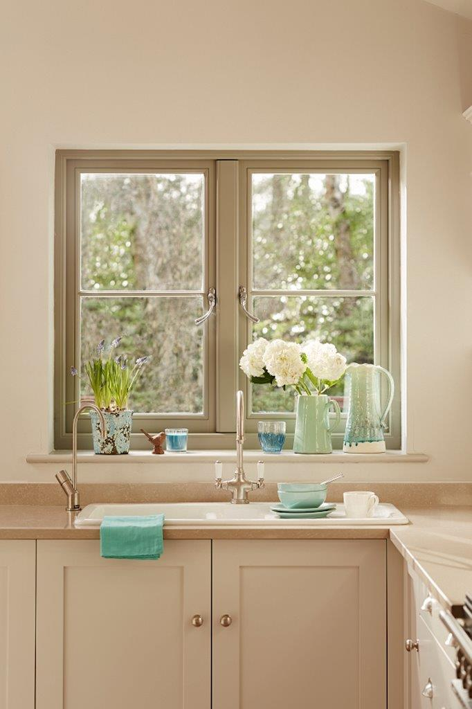 Kitchen window makeover featuring a new contemporary wooden window