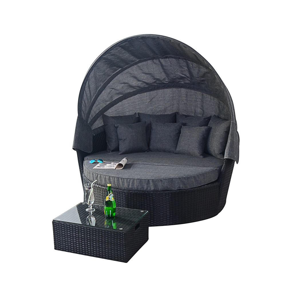 What a fabulous day bed to use in a garden. It looks so comfy and the canopy is useful for shade.