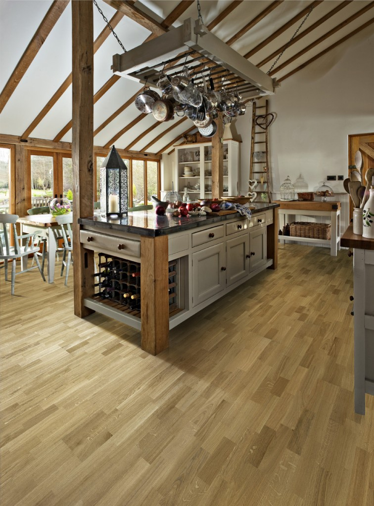 Engineered oak wood flooring can create a dramatic effect in a kitchen.