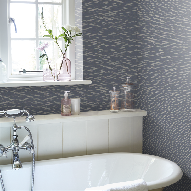 Ink blue River wallpaper, featuring a design echoing the movement of a river. Perfect for use in a bathroom.